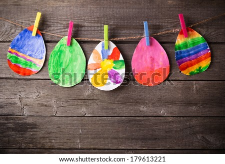 child's drawing of Easter eggs on wooden background - stock photo