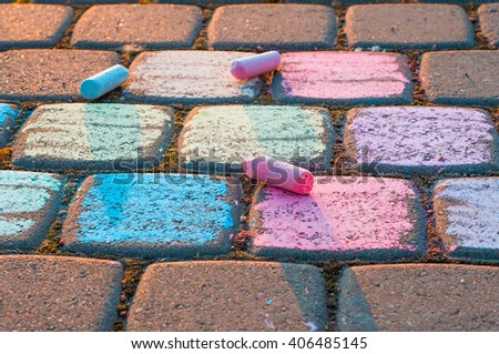 Child's drawing  on a street. Crayons on asphalt - stock photo