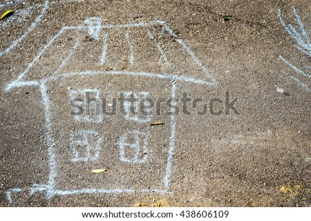 child's drawing with crayons on the pavement: a house with windows and roof, and free space for your text - stock photo