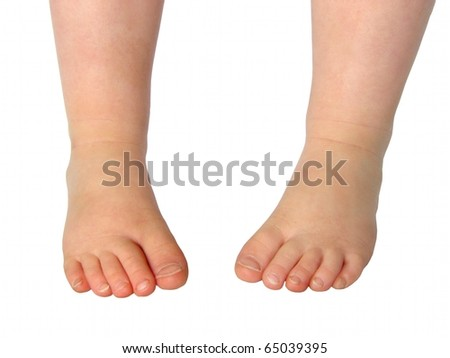 Child's feet isolated on white - stock photo