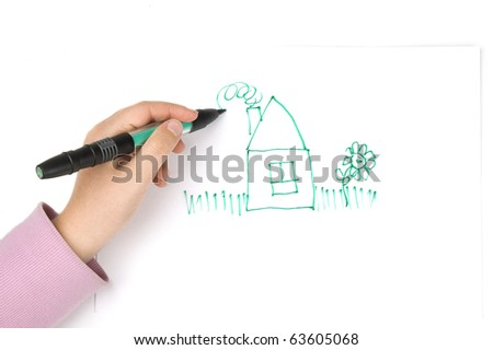 Child's hand drawing a house - stock photo