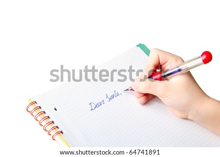 "Child's hand holding ink pen while writing letter to Santa Claus, asking for a Christmas' gift, text ""Dear Santa"" in checkered workbook with copy space for your message, background isolated on white - stock photo"