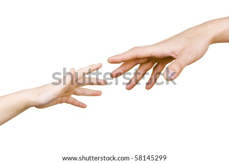 child's hand reaches for the male hand on a white background - stock photo