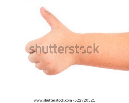 Child's hand showing thumb up on white background