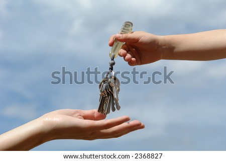 child's hand with keys - stock photo