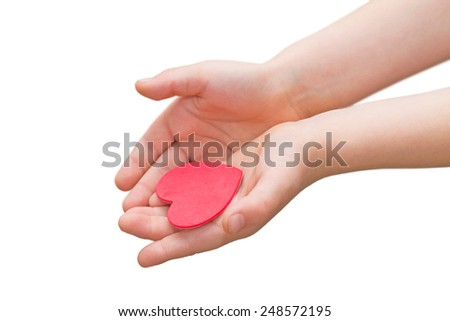 Child's hands holding a red heart - stock photo