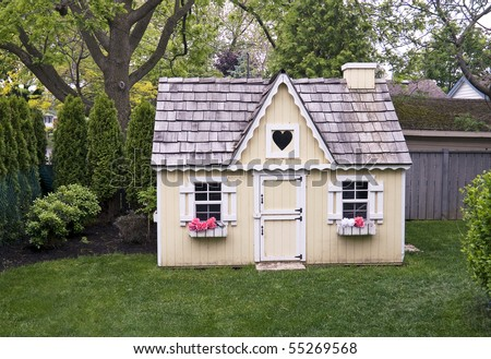 child's playhouse in the yard - stock photo