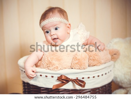 child's portrait in a basket