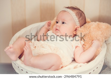 child's portrait in a basket - stock photo