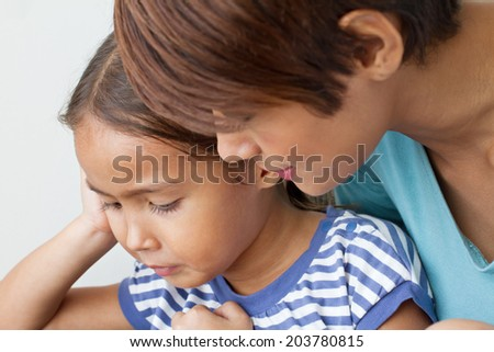 child's problem with caring mother; listening to her daughter's problem : facial close-up shot - stock photo