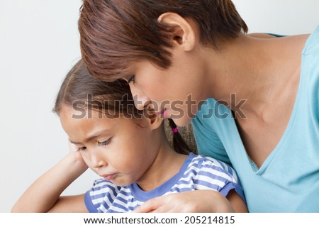 child's problem with caring mother; listening to her daughter's problem : head and shoulder shot - stock photo