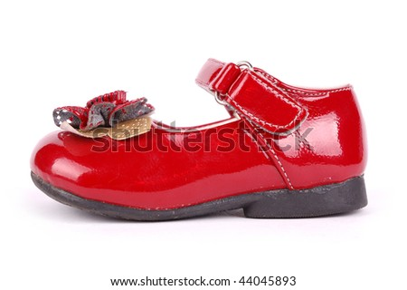 child's red shoe with fastenings on a white background - stock photo