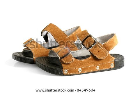 Child's sandals on a white background - stock photo