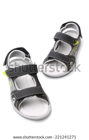 Child's sandals on white background - stock photo