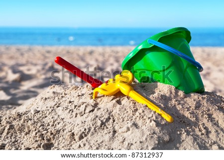 Child's toys on sandy beach, summer holidays concept - stock photo