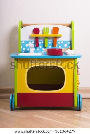 Child's wooden toy kitchen - stock photo
