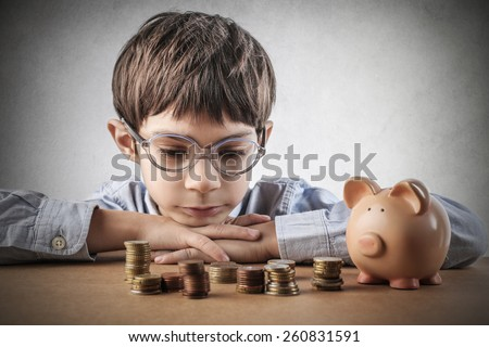 Child saving money  - stock photo