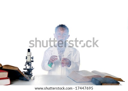 child scientist blowing up chemicals in his test tube and beaker - stock photo