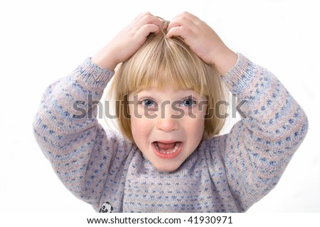 Child scratch head that itch or holds head in frustration or anger whilst screaming. boy isolated on white