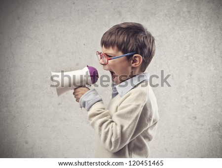Child screaming through a megaphone - stock photo