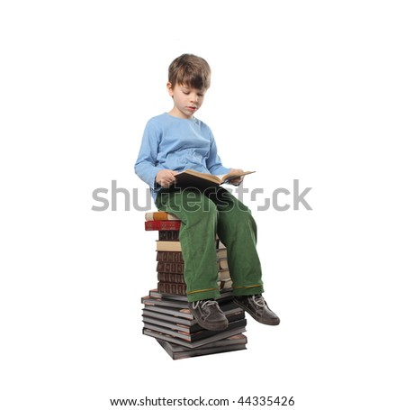 child seated on books' stack - stock photo