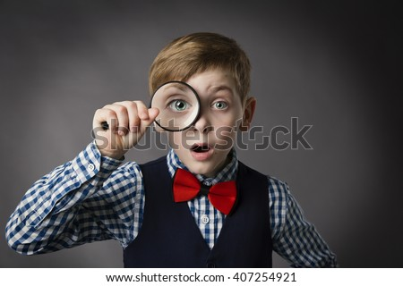Child See Through Magnifying Glass, Kid Eye Looking with Magnifier Lens over Gray