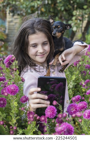 Child shooting flowers with tablet - stock photo