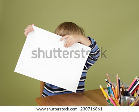 Child, showing blank page, arts and crafts - stock photo