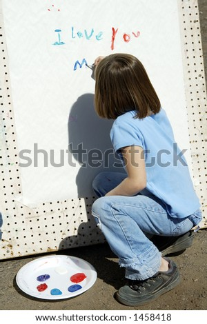 Child showing her artistic abilities during a street fair. - stock photo