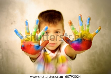 Child showing his colored hands - stock photo