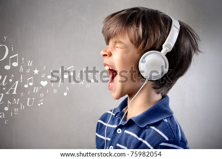 Child singing out loud while listening to music - stock photo