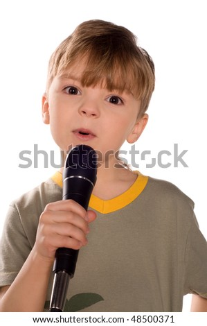 Child singing with a microphone. Funny little boy isolated on white background. Beautiful caucasian model.