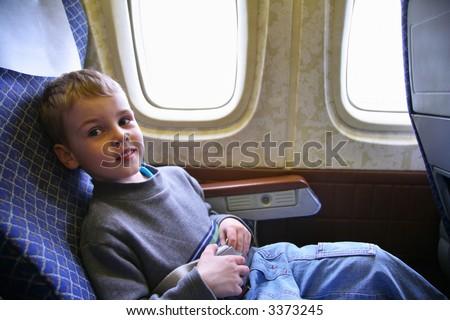 child sit in plane - stock photo