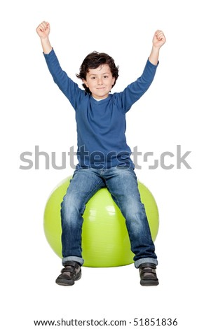 Child sitting on a pilates ball isolated on a over white background - stock photo