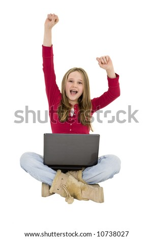 Child sitting on a white background with a laptop computer