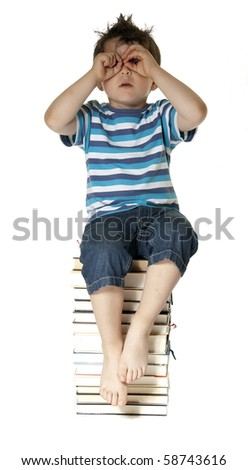 Child sitting on books and looking to you