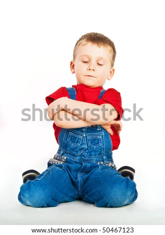 Child sitting on the floor like a boss - stock photo