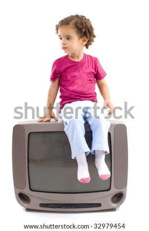 Child sitting on top of old television .