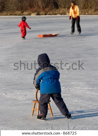 Child Skating with help of Chair - stock photo