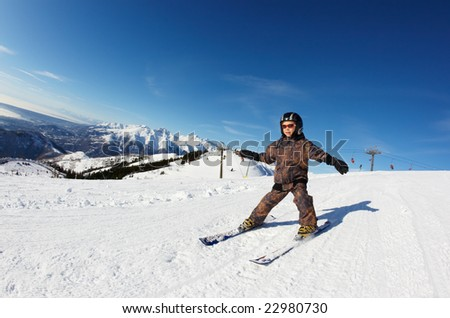 Child skiing on a slope against a clear sky. Bielmonte, Biella, Piemonte, Italy