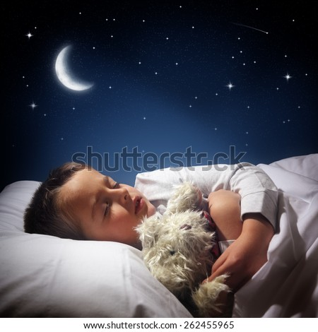 Child sleeping and dreaming in his bed under the moon, stars and blue night sky - stock photo
