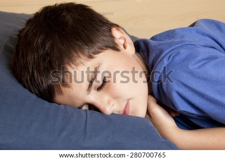 child sleeping in bed - stock photo
