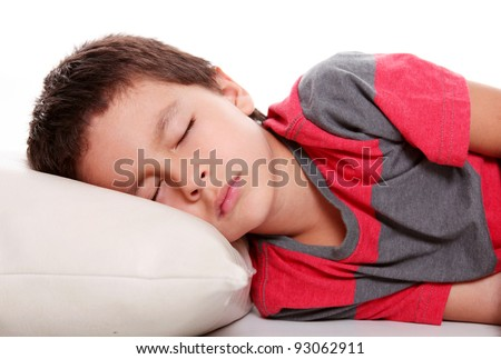 Child sleeping on white pillow and empty background, studio shoot