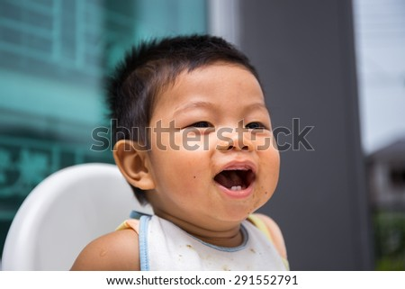 Child smile and laugh during eating