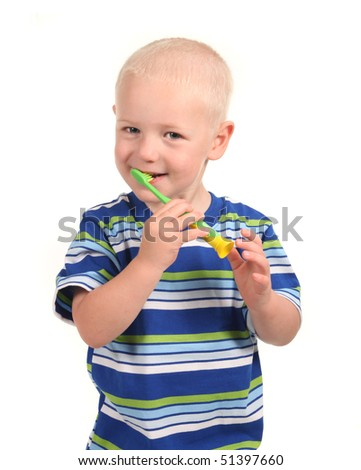 Child Smiling and Brushing His Teeth on White Background - stock photo