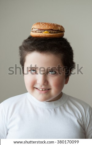 child  smiling  eat  burger  head desire fast food - stock photo
