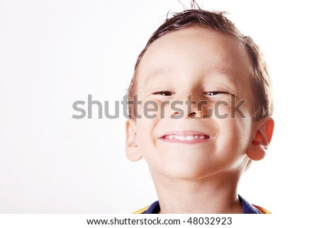 Child smiling over white background. Four years old