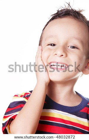 Child smiling with his hand in his face, 4 years old
