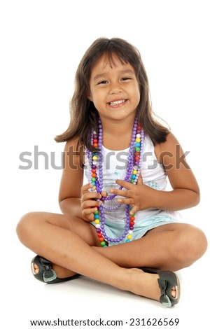 Child smilling and using colors necklace - stock photo