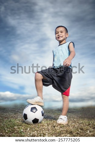 Child soccer player on soccer field - stock photo